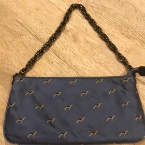 J Crew purse. Blue with dogs . Zip closure
